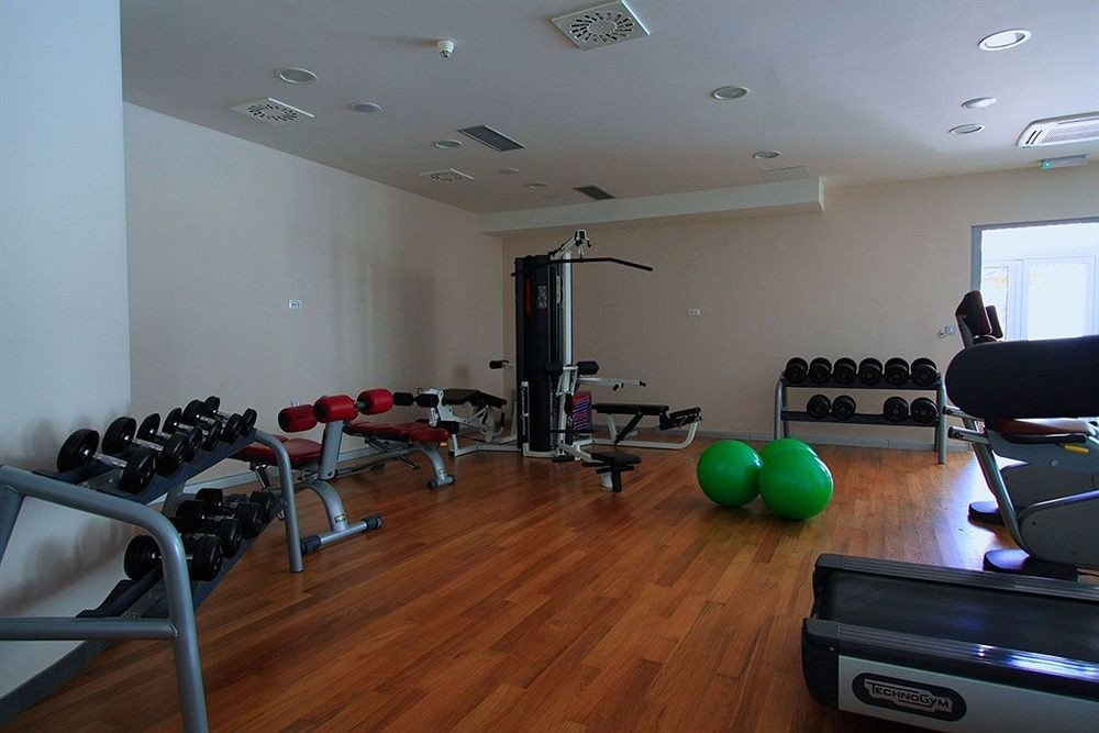structure property sport venue condominium recreation room living room hard cluttered