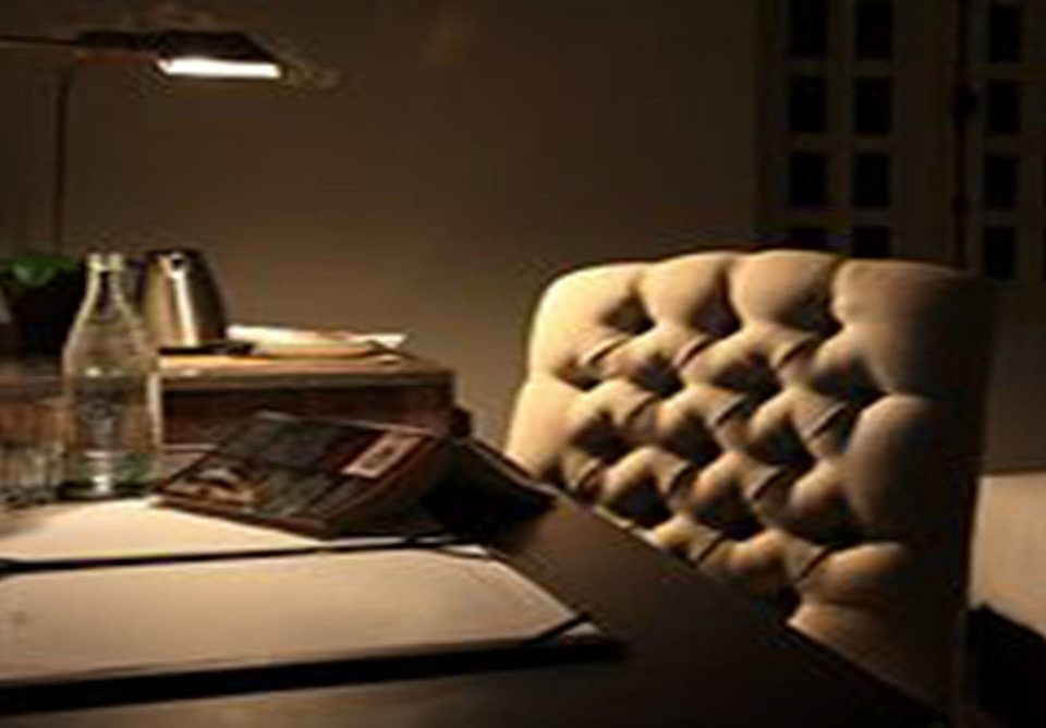 living room lighting seat conference room cluttered