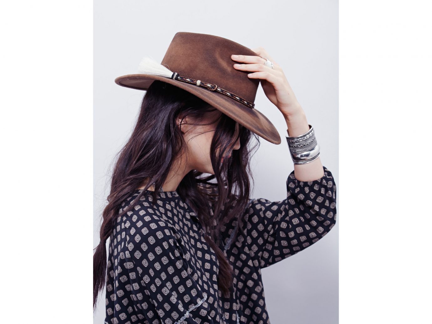 Style + Design person clothing woman hat cap pattern fashion accessory Design polka dot outerwear neck headgear fedora