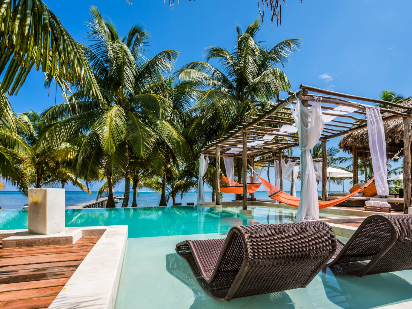 Trip Ideas tree sky outdoor leisure Resort property chair vacation swimming pool Beach caribbean Pool estate arecales palm Villa condominium lined area furniture shade