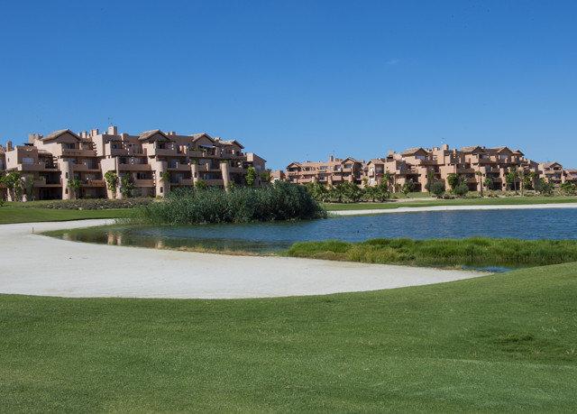 grass sky structure sport venue golf course residential area aerial photography golf club Coast reservoir panorama terrain shore