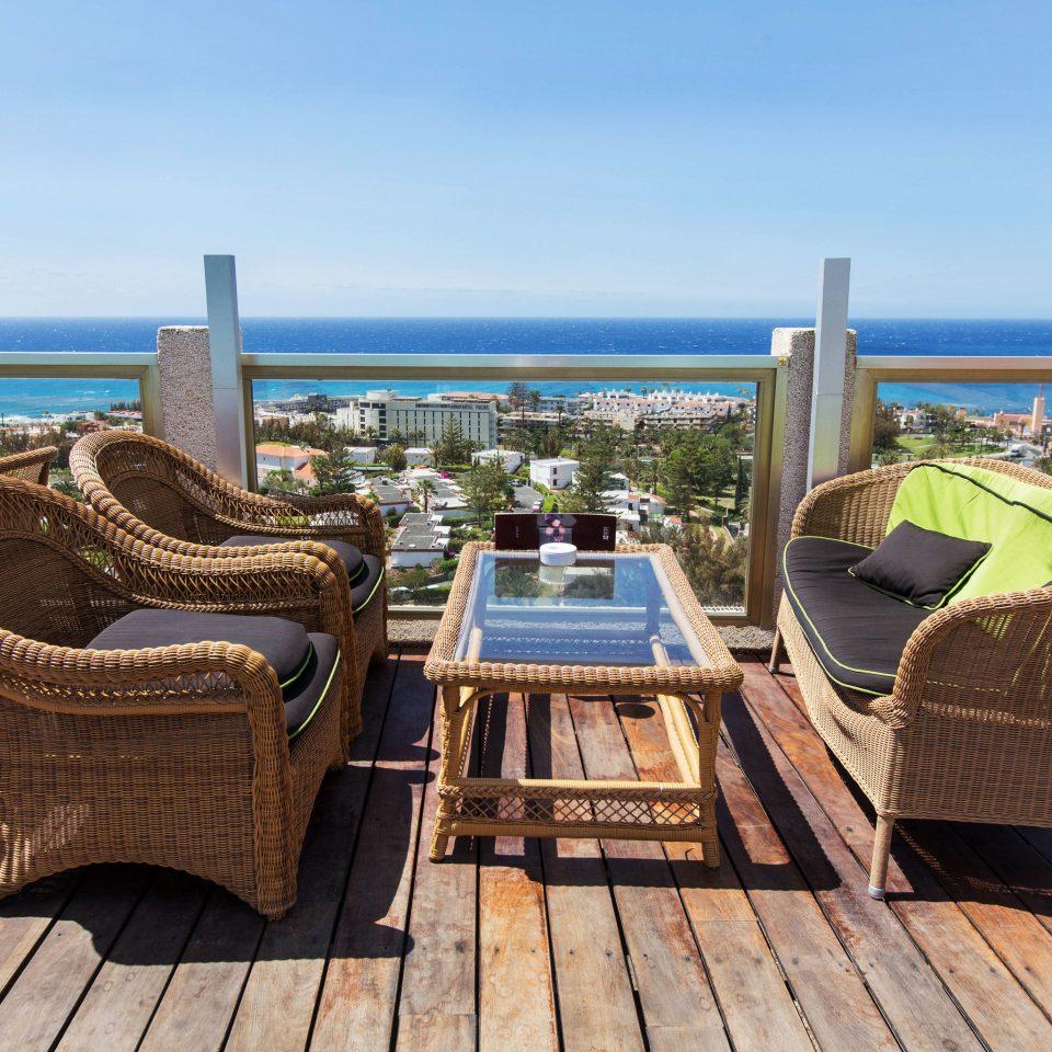 sky ground water wooden chair leisure property walkway Sea Resort Coast vehicle dock boardwalk swimming pool Villa overlooking Deck shore