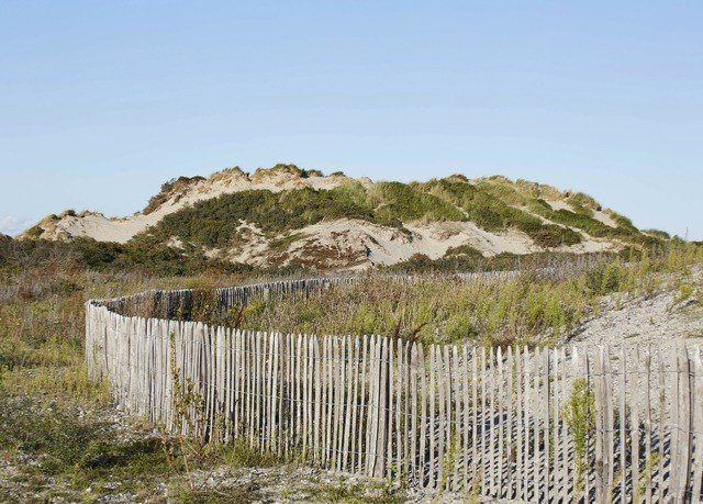 Fence grass building ecosystem badlands cliff Coast terrain plateau geology formation pasture