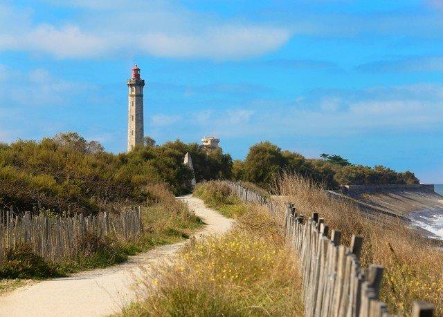 grass sky building tower Coast lighthouse path hill Sea cliff waterway cape terrain walkway Fence hillside