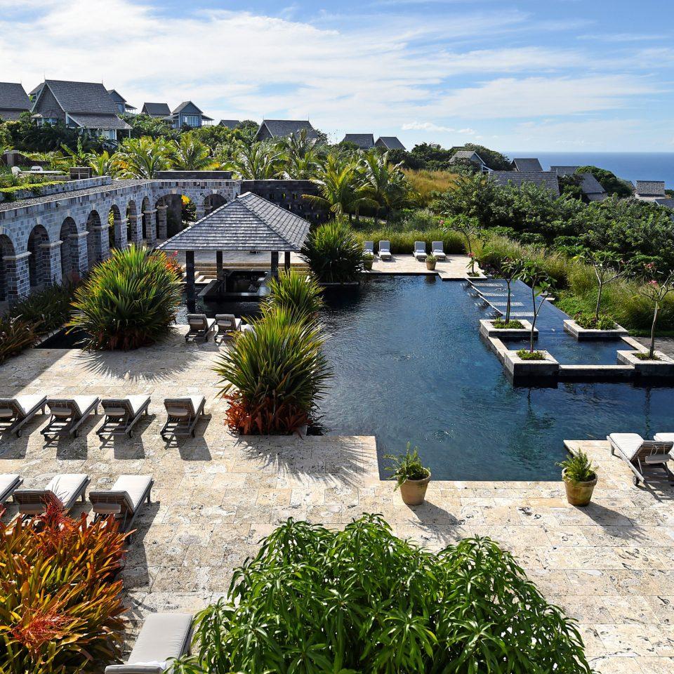 Hotels Trip Ideas sky building Town Village Coast Sea waterway Resort travel flower stone Garden