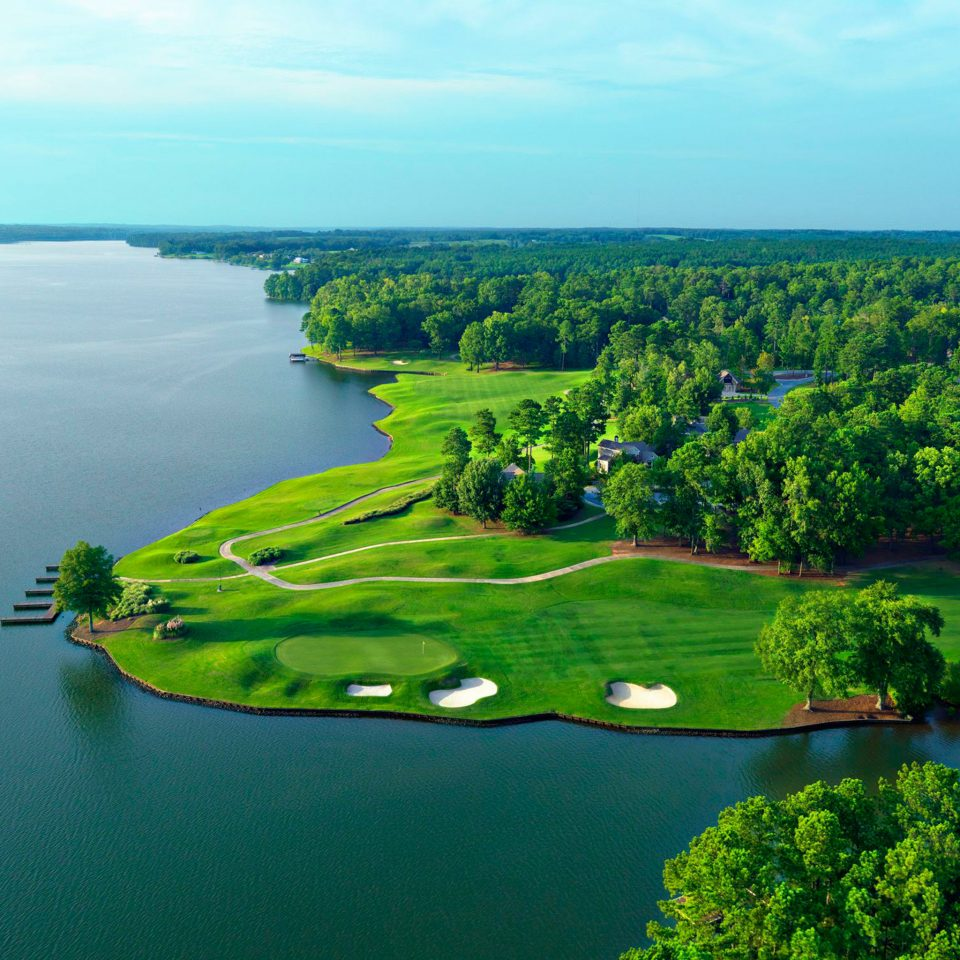 Grounds Nature Outdoor Activities Waterfront sky water green structure aerial photography tree horizon sport venue River hill Sea reservoir Lake landscape Coast archipelago golf course wetland reef lush shore land