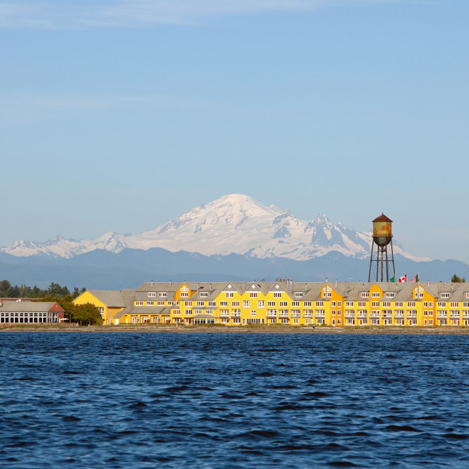 sky water Sea horizon shore yellow Ocean Coast River vehicle ferry Harbor tower skyline distance