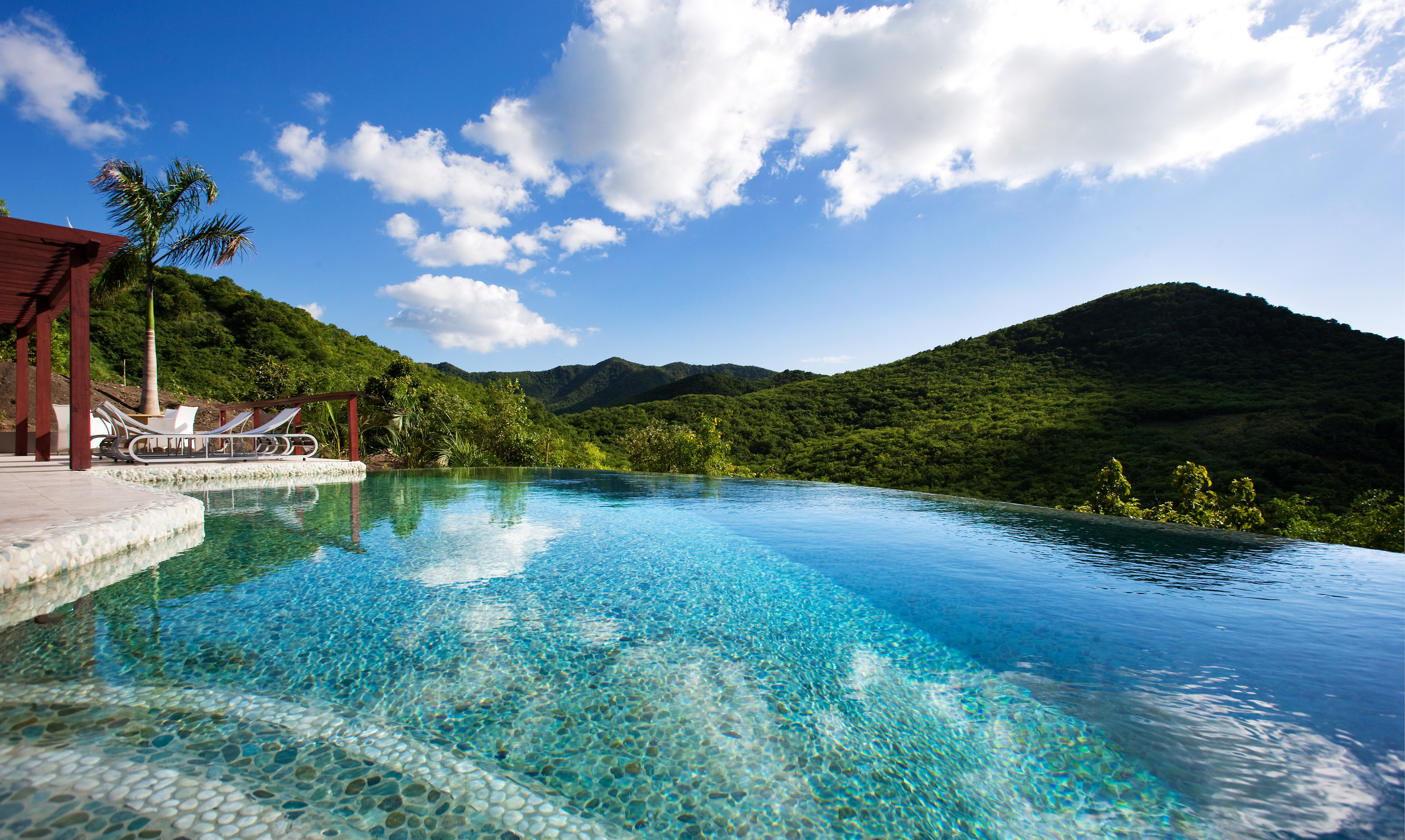 Hotels Trip Ideas sky water mountain Nature Sea Lake Lagoon Coast reservoir swimming pool surrounded day Island