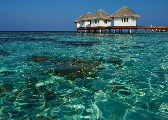 water sky Sea house Ocean caribbean Nature Lagoon Coast Island cay blue Resort islet shore swimming