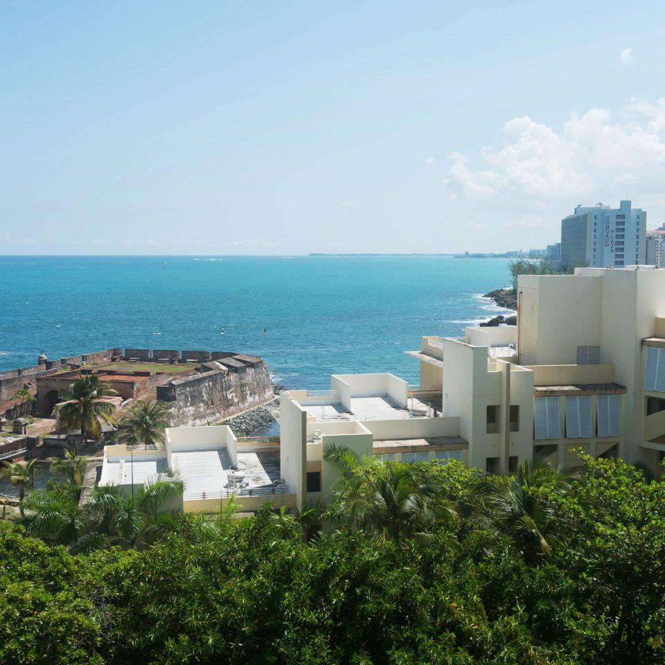 sky tree property Nature Sea Coast Ocean condominium Resort cape overlooking shore Island