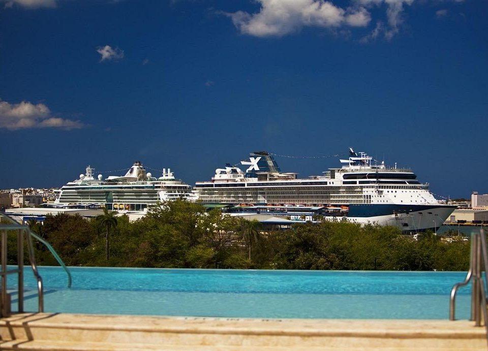sky water passenger ship Sea vehicle caribbean cruise ship marina dock ship Ocean blue Resort Coast watercraft shore landing Island