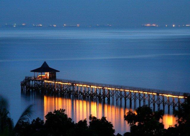 water sky horizon night landmark dusk dawn evening sunrise Ocean Sea Sunset Coast pier tower bridge light skyline cityscape Lake distance