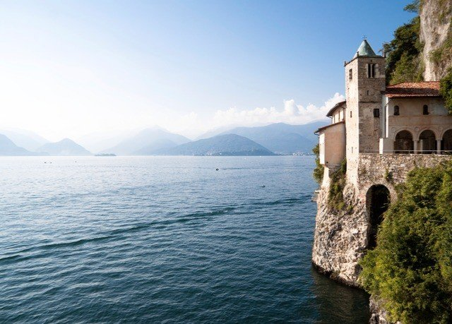 water sky building Sea Coast Lake cliff terrain traveling surrounded hillside