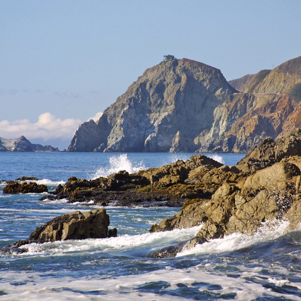 Natural wonders Nature Ocean Outdoor Activities Outdoors mountain sky water Coast rock Sea cliff shore Winter snow terrain landscape cape wave geology mountain range ice