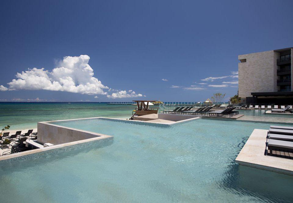 sky property Sea swimming pool Ocean marina Nature Resort dock vehicle condominium Coast ramp Villa shore