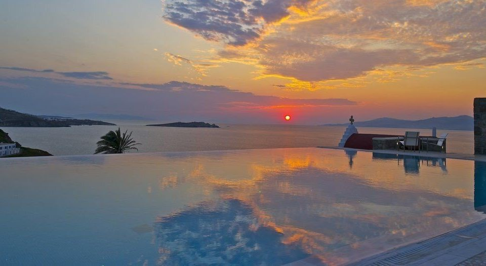 sky water Sea Sunset sunrise horizon dawn afterglow Ocean Coast cloud Nature dusk morning evening clouds shore
