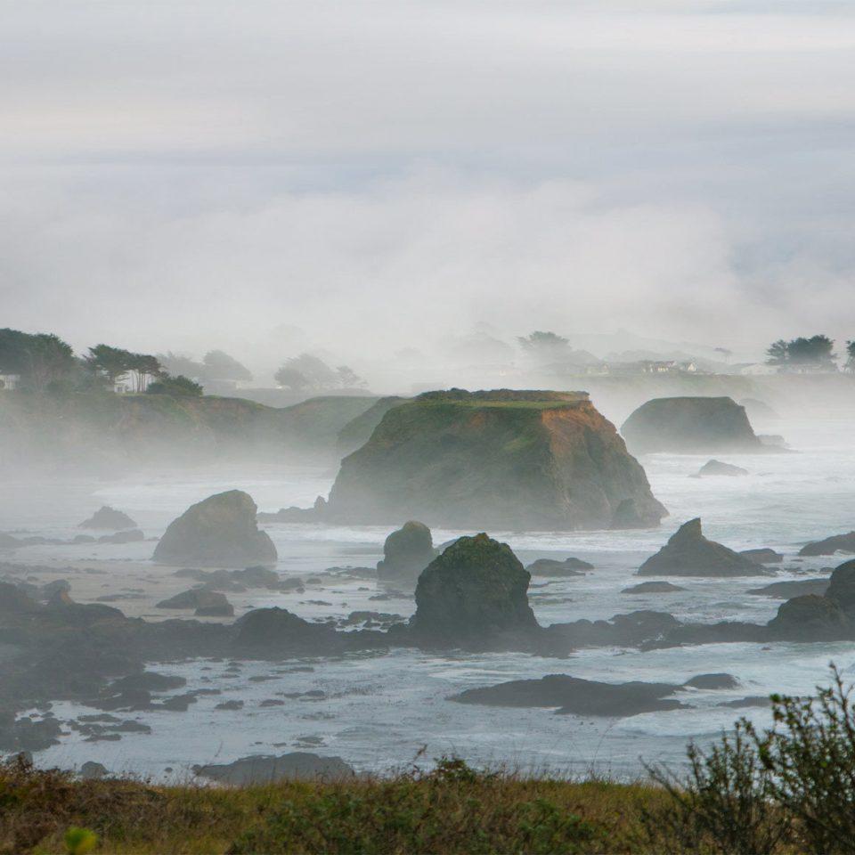 water sky Nature atmospheric phenomenon mountain Coast wind wave Ocean wave weather Sea cloud mist shore morning iceberg terrain cliff ice promontory rock