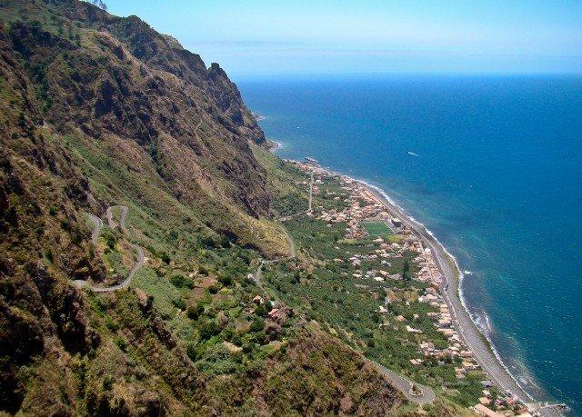 Nature mountain sky water Coast cliff promontory hill Sea rocky terrain overlooking cape aerial photography ridge hillside high