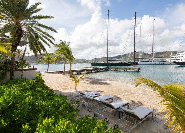 sky tree water marina dock River Resort Coast Sea arecales caribbean palm walkway shore day