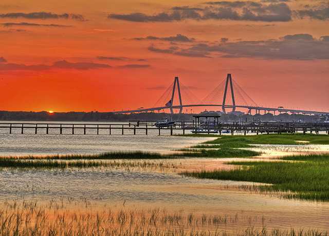 grass sky Sunset horizon bridge sunrise dawn shore plain dusk River Sea morning cloud prairie Coast evening landscape skyline marsh orange cityscape nonbuilding structure wetland setting