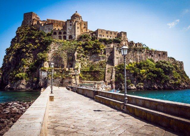 water sky building historic site Town landmark Coast Sea stone Ruins ancient history monastery Village tours unesco world heritage site terrain travel walkway