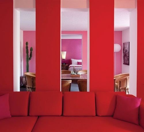 red color sofa seat property living room pink colored