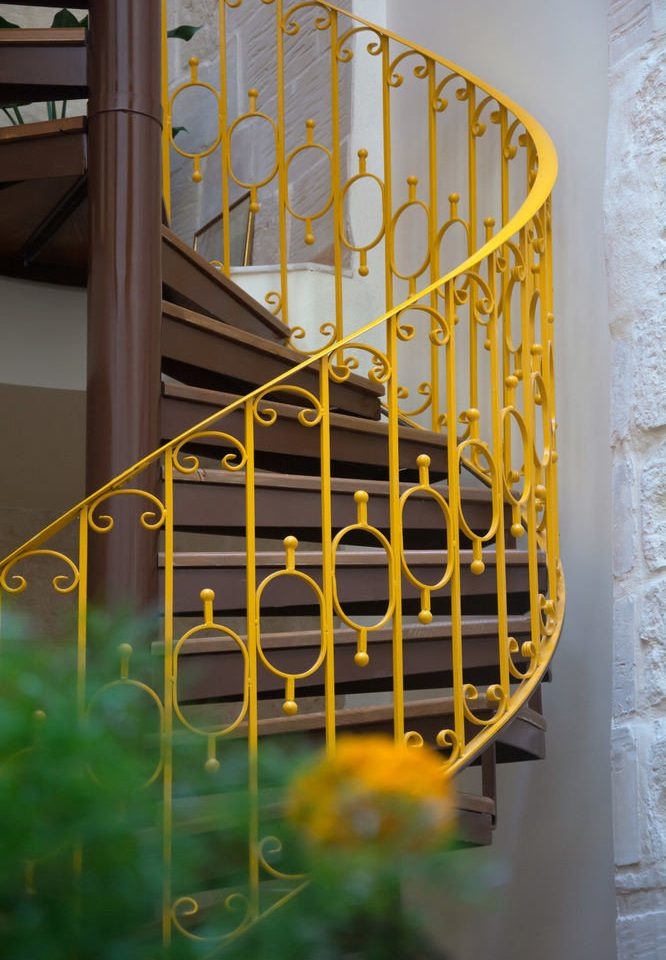 yellow color stairs handrail glass