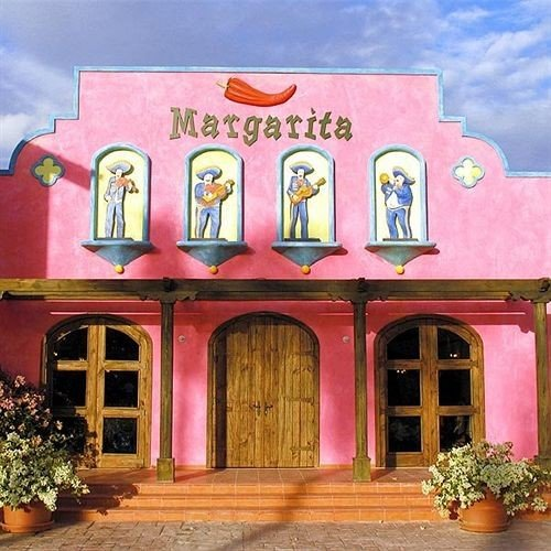 pink hacienda restaurant old colorful painted colored