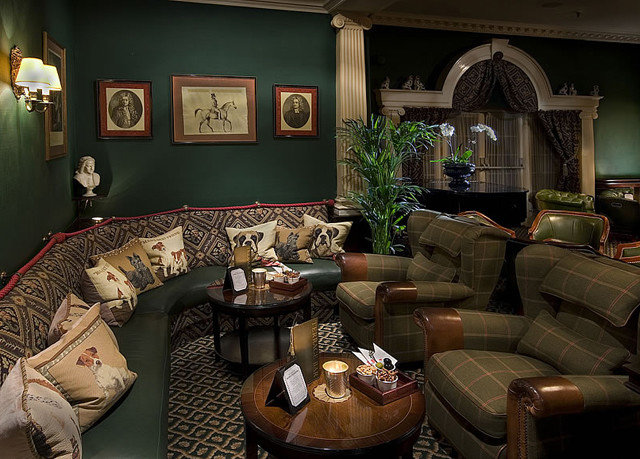 sofa living room property home mansion recreation room screenshot cottage seat colored leather