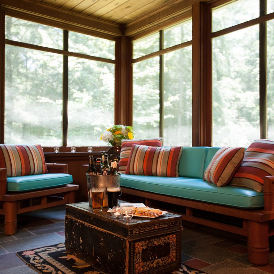 sofa living room property home hardwood porch cottage farmhouse colorful overlooking