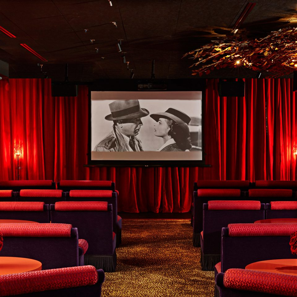 red stage movie theater nightclub theatre function hall colorful