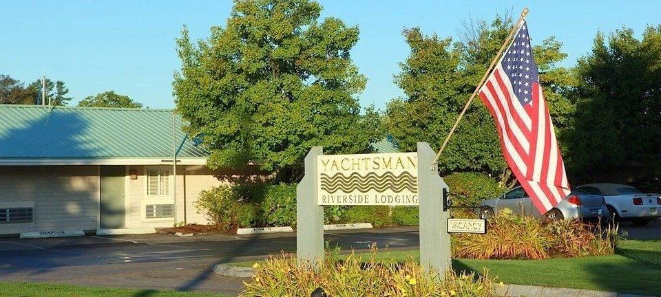 tree grass sky community home memorial sign