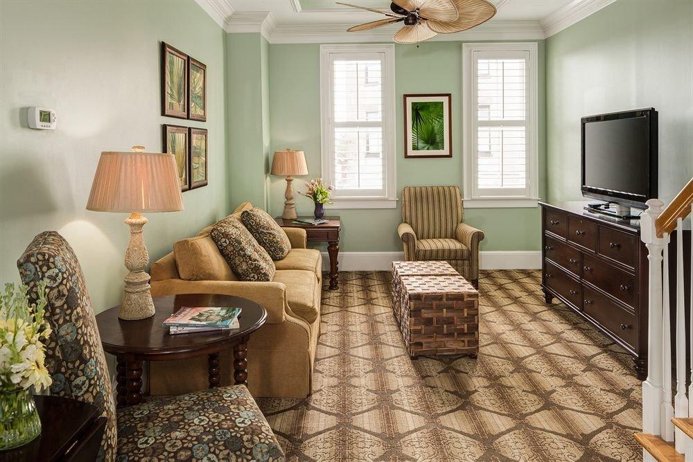 sofa property living room home cottage hardwood condominium farmhouse flooring wood flooring rug