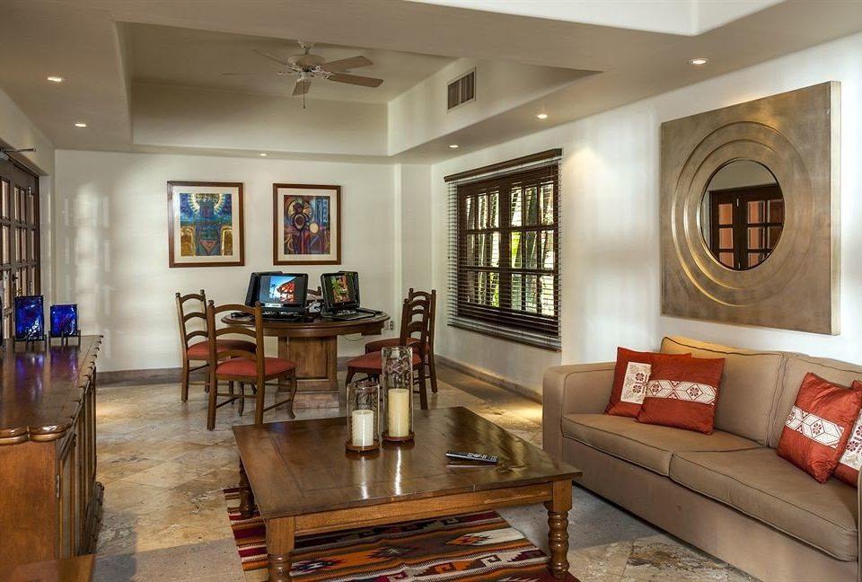 sofa living room property home hardwood cottage recreation room mansion farmhouse condominium leather