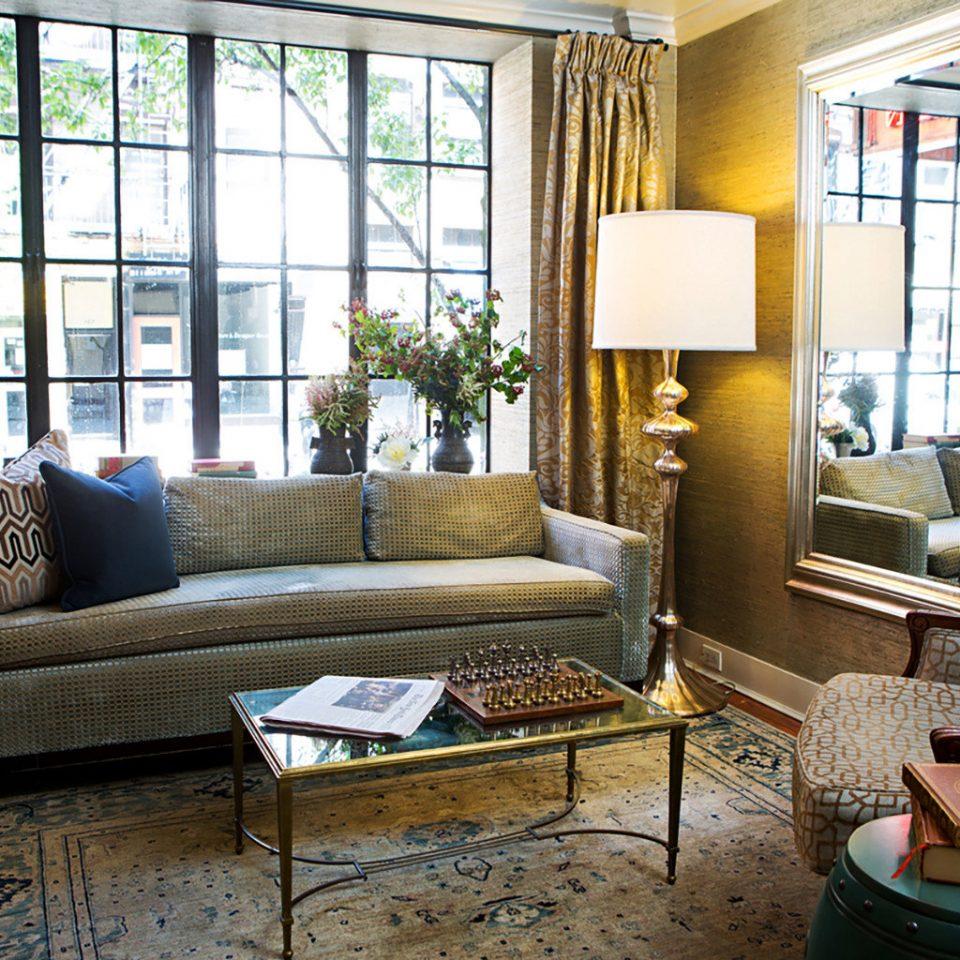 sofa living room property home house porch cottage condominium farmhouse rug