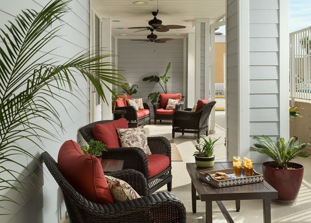 living room property plant home porch condominium outdoor structure cottage leather