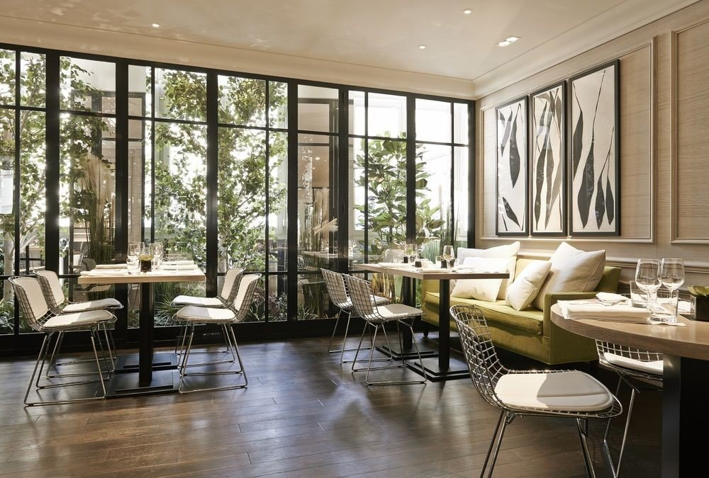 property living room condominium home hardwood wood flooring flooring leather dining table
