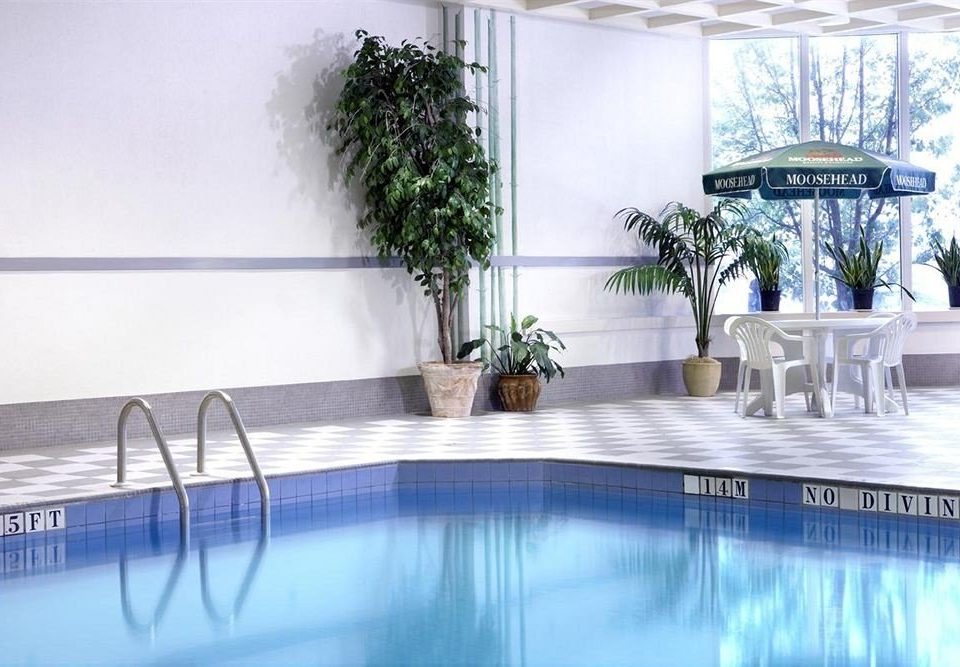 swimming pool property condominium reflecting pool dining table