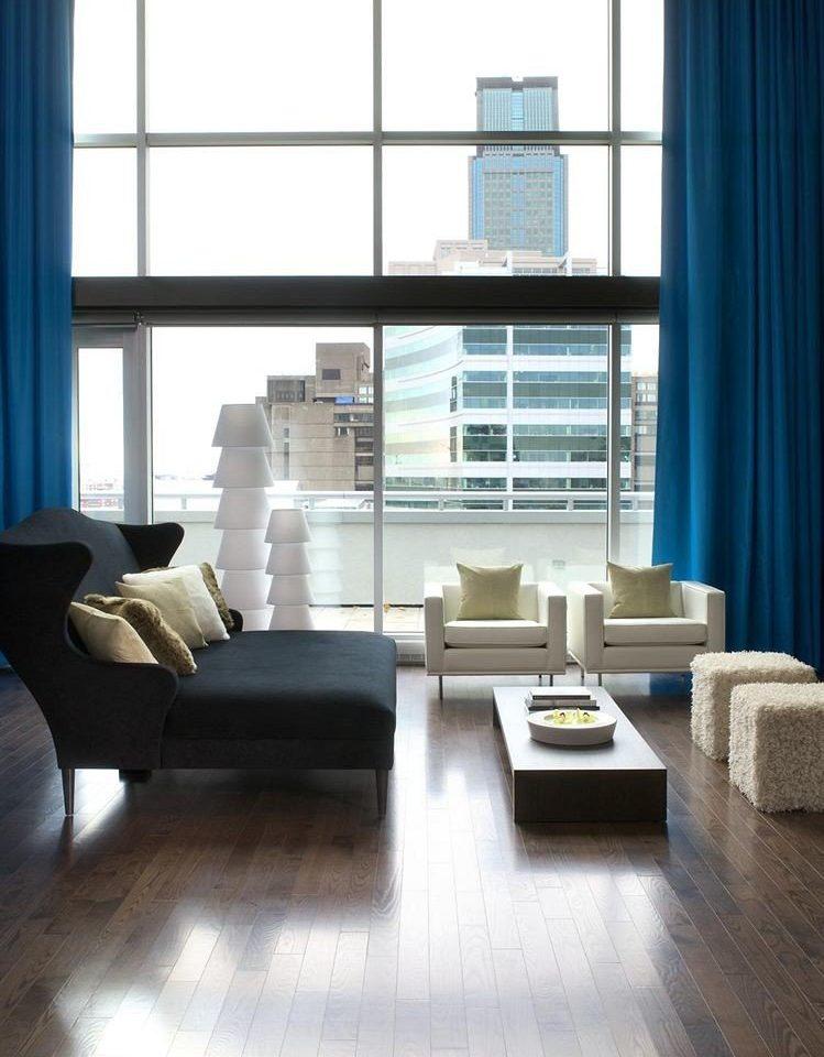 living room property hardwood flooring home wood flooring condominium laminate flooring loft sofa