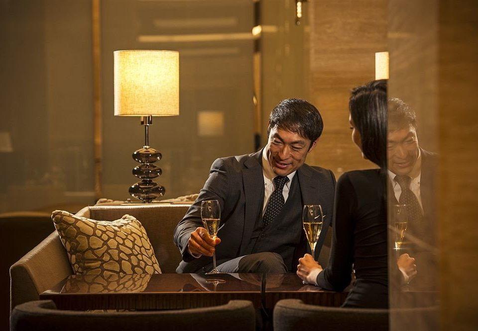 man suit gentleman conversation restaurant human behavior