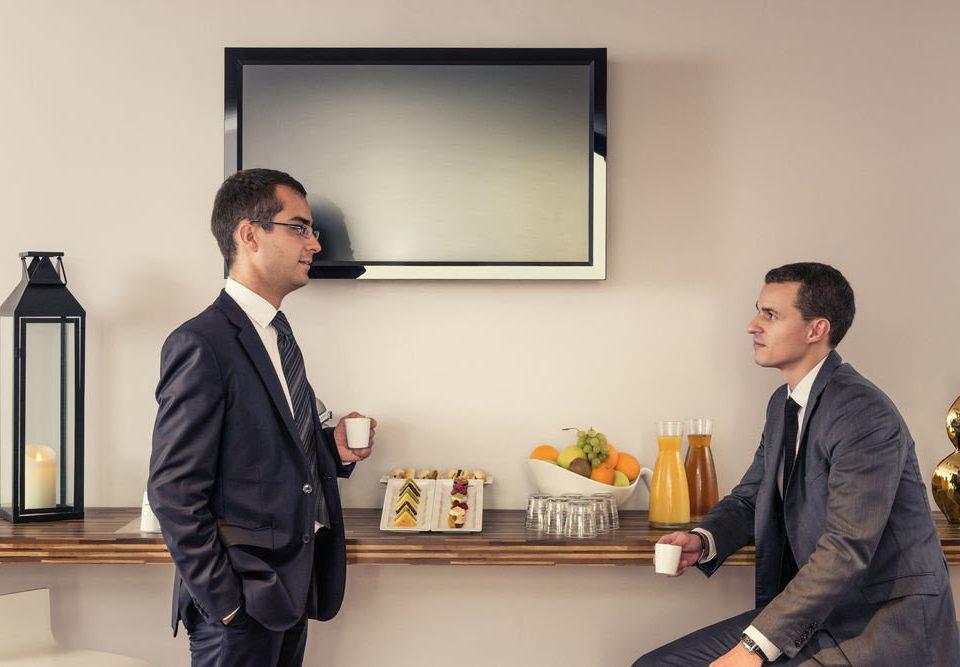 man standing conversation suit office receptionist