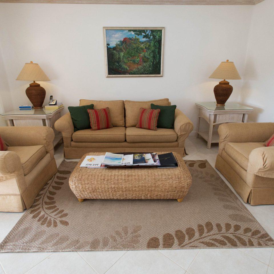 living room property home hardwood flooring couch cottage laminate flooring wood flooring tan