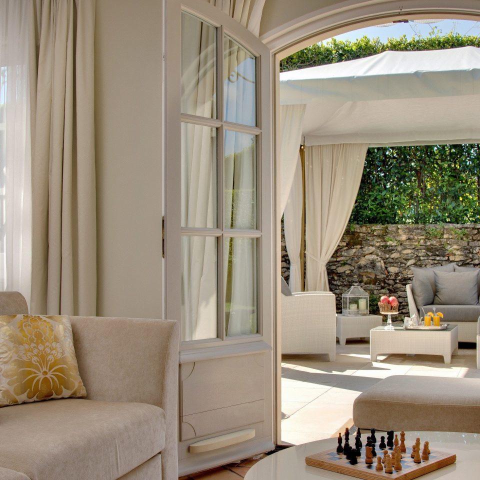 sofa living room property home porch cottage curtain window treatment farmhouse