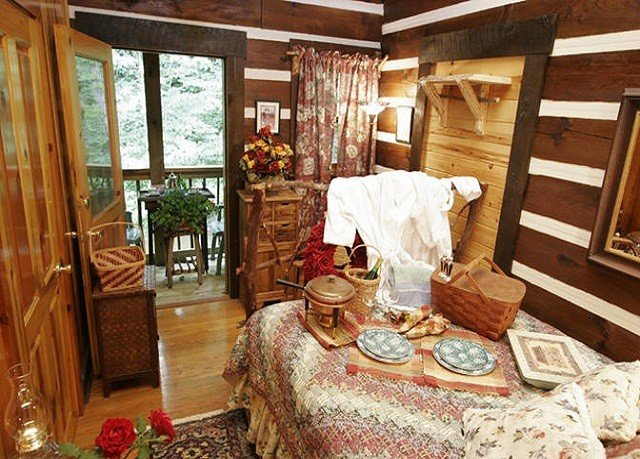 property home cottage log cabin living room porch farmhouse dining table