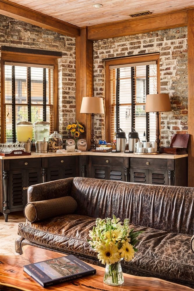 sofa living room property home porch hardwood farmhouse cottage wooden wood flooring leather