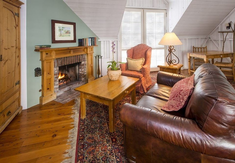 sofa property living room home house hardwood cottage leather farmhouse wood flooring
