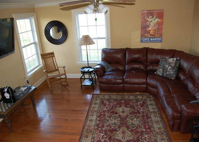 sofa property living room home hardwood cottage flooring wood flooring rug leather hard