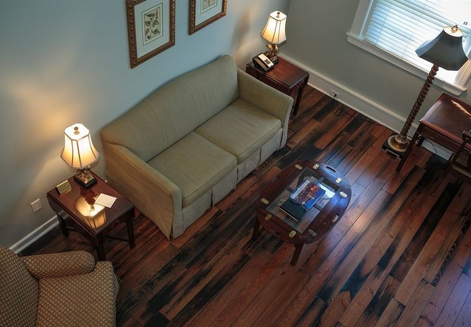 sofa property living room home house hardwood wood flooring flooring screenshot cottage leather