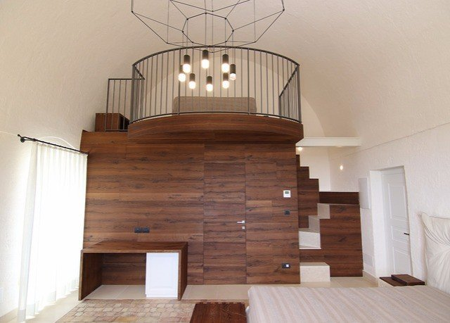 property stairs wooden hardwood wood flooring cottage living room hearth