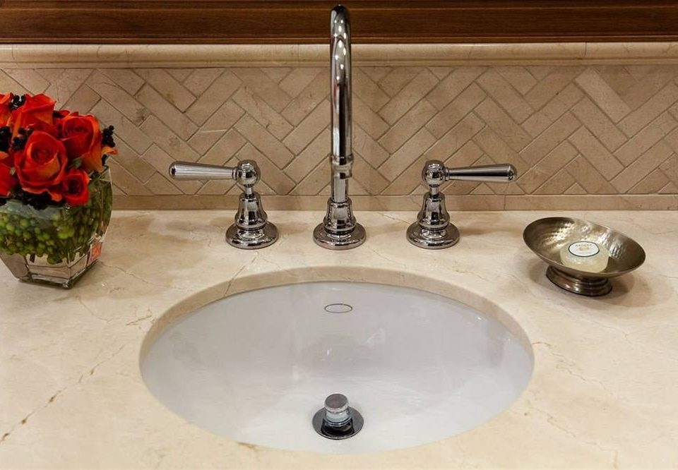sink plumbing fixture counter countertop flooring material tap toilet water basin